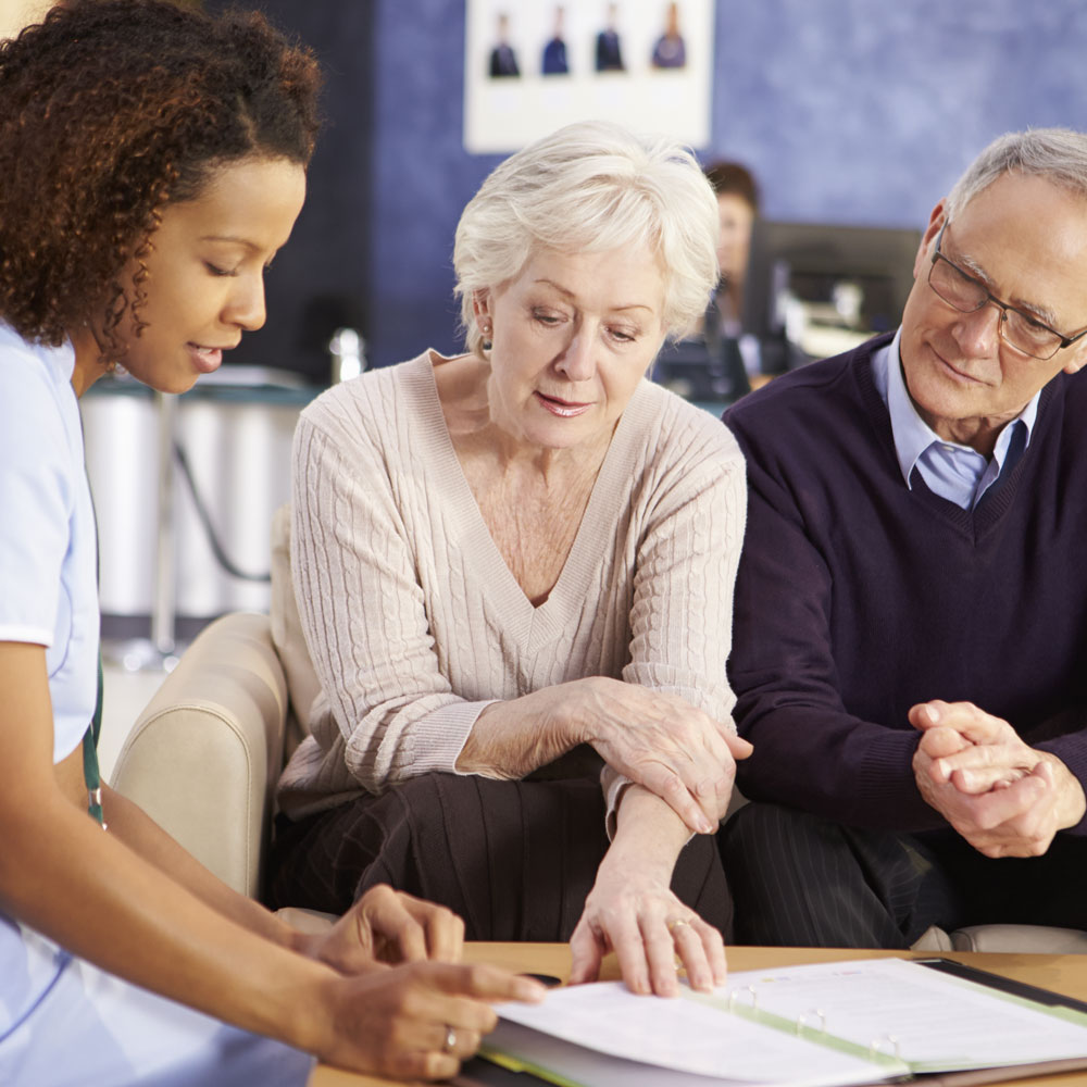 Couple consulting with caregiver