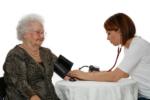 Nurse taking client's blood pressure