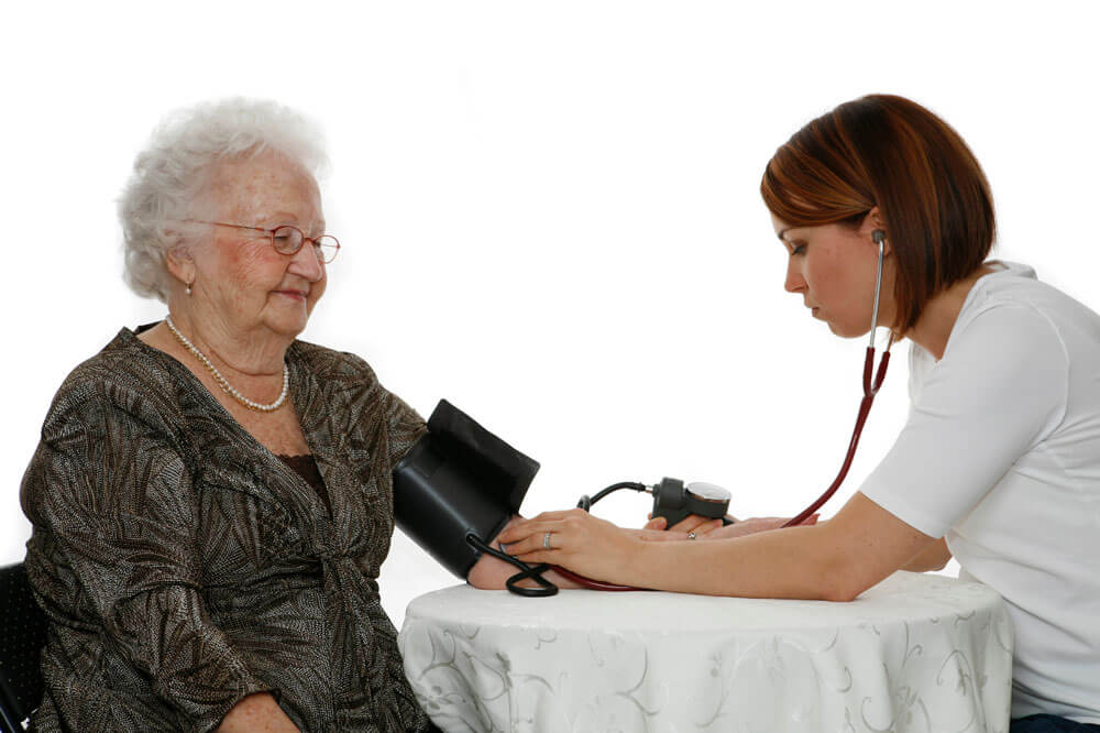 Nurse taking client's blood pressure